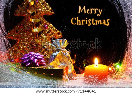 Merry Christmas still-life with christmas gifts behind snowy window - stock photo