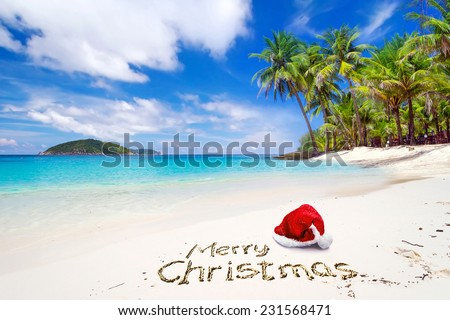 Merry Christmas with santa hat from the tropical beach - stock photo