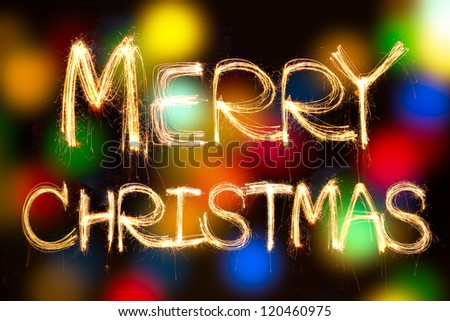 merry christmas written with Sparkling figures. on bokeh background - stock photo