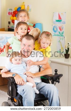 merry company of children with gay men disabled - stock photo