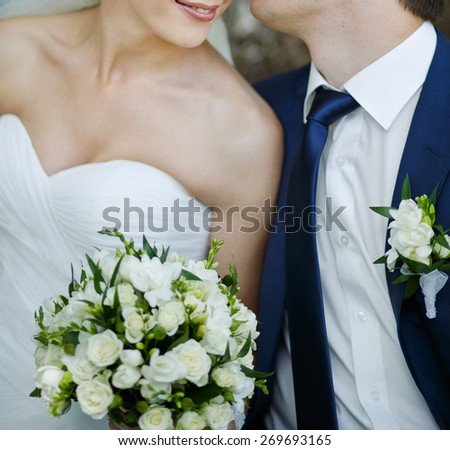 Merry day we sit together and kissing each other.  Wedding couple in love.  - stock photo