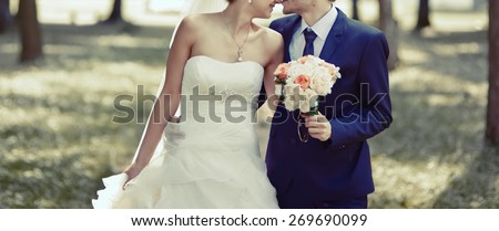 Merry day we walk together away. Wedding couple in love.  - stock photo