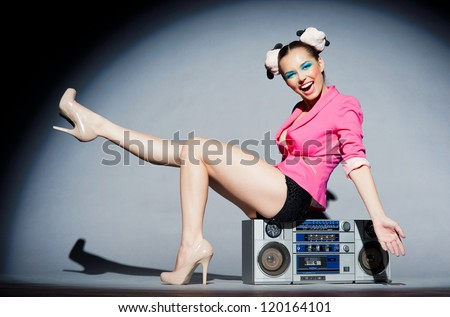 Merry disco girl with a tape recorder - stock photo