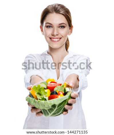 merry european woman & vegetable salad / attractive girl of the european appearance after taking a shower eats a vegetable salad from transparent crockery - isolated on white background  - stock photo