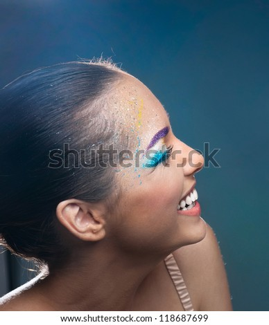 Merry face of girl with bright makeup - stock photo