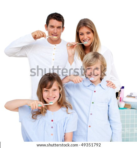 Merry family brushing their teeth  in the bathroom