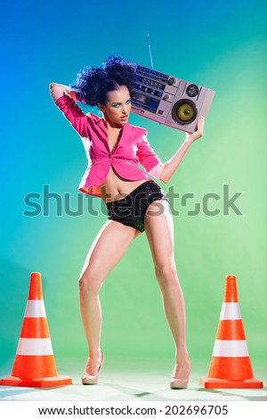 Merry girl with a tape recorder on the disco - stock photo