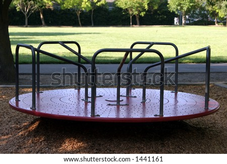 Merry go round at the park. - stock photo