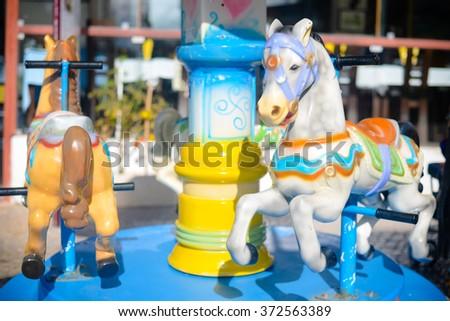 Merry Go Round horse carousel carnival. Joyful time concept - stock photo