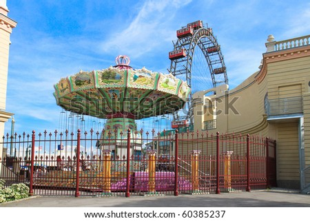 Merry-go-round spinning and Vienna Prater Famous Old Ferries Wheel , Austria - stock photo