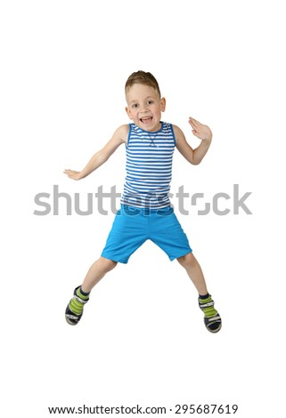Merry little boy in shorts and shirt jumps isolated on white background - stock photo