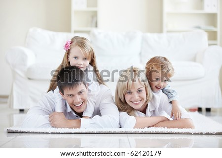 Merry parents with children at home - stock photo