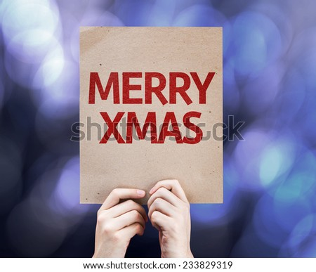 Merry Xmas written on colorful background with defocused lights - stock photo