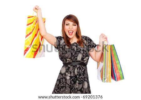 merry young woman holding shopping bags. isolated on white background