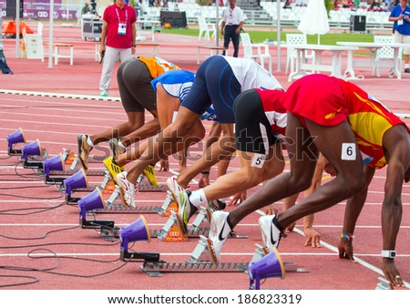 MERSIN - TURKEY - JUNE 26: Unidentified athlets start at the 100 m. race competes at the Mediterranean Games Championships June 26, 2013 in Mersin Turkey  - stock photo
