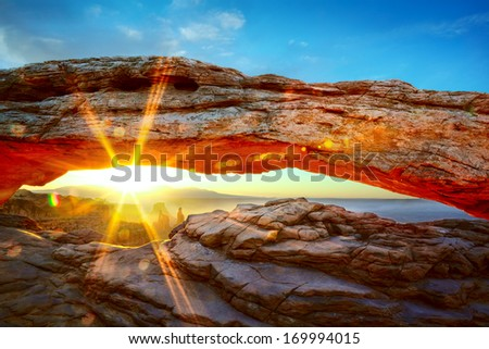 Mesa Arch at sunrise in Canyonlands National Park, Utah, USA - stock photo