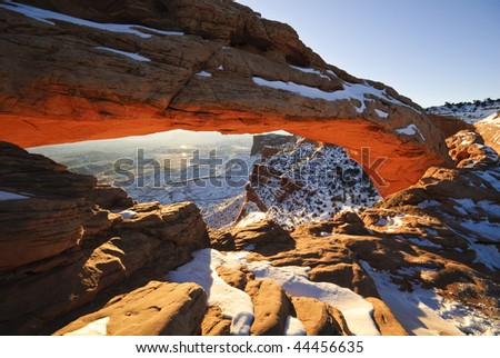 Mesa arch at sunrise in winter. Canyonlands National Park. USA - stock photo