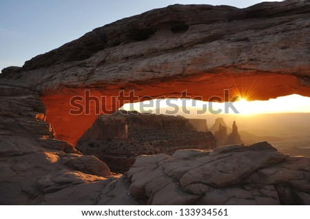 Mesa Arch in Canyonlands National Park at Sunrise - stock photo