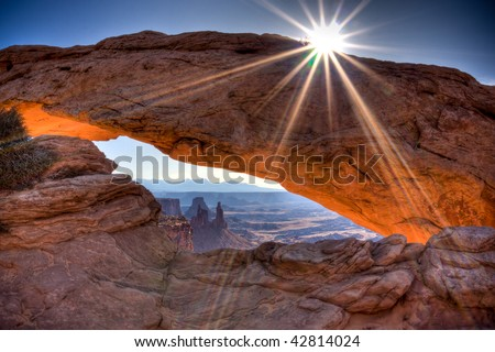 Mesa Arch spans 90 feet and stands thousands of feet above the Colorado River gorge. This image is processed with 3 images in HDR. - stock photo