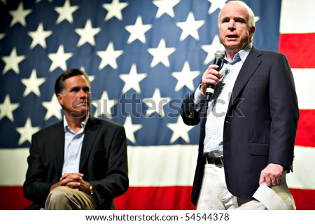 MESA, AZ - JUNE 4: Former Massachusetts Governor Mitt Romney and Senator John McCain appear at a town hall meeting on June 4, 2010 in Mesa, Arizona. - stock photo