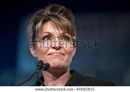 MESA, AZ - MARCH 27: Former Republican Vice Presidential candidate Sarah Palin addresses voters at a re-election rally in support of Arizona Senator John McCain on March 27, 2010 in Mesa, AZ. - stock photo