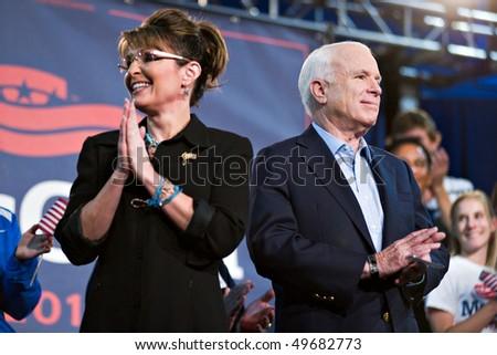 MESA, AZ - MARCH 27: Senator John McCain and former Vice Presidential candidate Sarah Palin attend a re-election rally for  Senator McCain on March 27, 2010 in Mesa, AZ. - stock photo