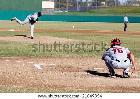 MESA, AZ - NOV 20: Pitcher Kevin Pucetas of the Scottsdale Scorpions warms up with catcher Tim Duff in the Arizona Fall League  game with the Mesa Solar Sox on November 20, 2008 in Mesa, Arizona.