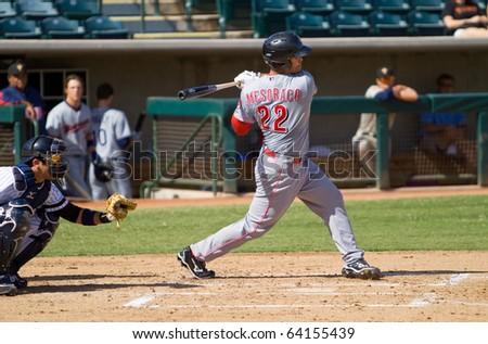 MESA, AZ - OCT. 19: Devin Mesoraco, the Cincinnati Reds' first-round pick in 2007, bats for the Peoria Saguaros in an Arizona Fall League game Oct. 19, 2010 at Phoenix Municipal Stadium. - stock photo