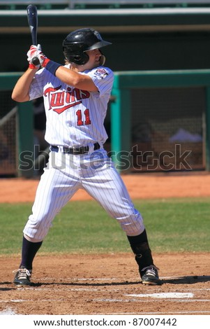 MESA, AZ - OCTOBER 17: Brian Dozier, a Minnesota Twins prospect, bats for the Mesa Solar Sox in an Arizona Fall League game Oct. 17, 2011 at HoHoKam Stadium in Mesa, AZ. Dozier went 2-for-4 with an RBI. - stock photo