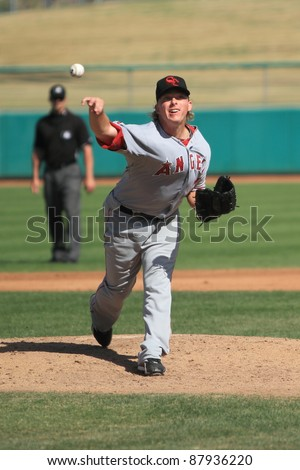 MESA, AZ - OCTOBER 26: Chris Scholl, a Los Angeles Angels prospect, delivers a pitch for the Scottsdale Scorpions in the Arizona Fall League on Oct. 26, 2011 at HoHoKam Stadium, Mesa, AZ. - stock photo