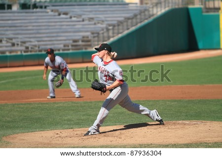 MESA, AZ - OCTOBER 26: Chris Scholl, a Los Angeles Angels prospect, delivers a pitch in the Arizona Fall League on Oct. 26, 2011 at HoHoKam Stadium, Mesa, AZ. Scholl gave up 6 runs on 6 hits. - stock photo