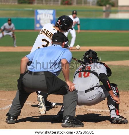 MESA, AZ - OCTOBER 17: Jarek Cunningham, a Pittsburgh Pirates prospect, bats for the Mesa Solar Sox in an Arizona Fall League game Oct. 17, 2011 at HoHoKam Stadium. Cunningham belted two homers. - stock photo