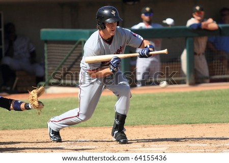 MESA, AZ - OCTOBER 19: Joe Benson, top prospect for the Minnesota Twins, bunts for the Peoria Saguaros in an Arizona Fall League game Oct. 19, 2010 at Phoenix Municipal Stadium. Benson later doubled.