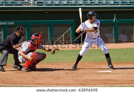 MESA, AZ - OCTOBER 18: Jordy Mercer, a top shortstop prospect for the Pittsburgh Pirates, bats for the Mesa Solar Sox in an Arizona Fall League game Oct. 18, 2010 at HoHoKam Stadium in Mesa, Arizona. Mesa lost, 4-2. - stock photo
