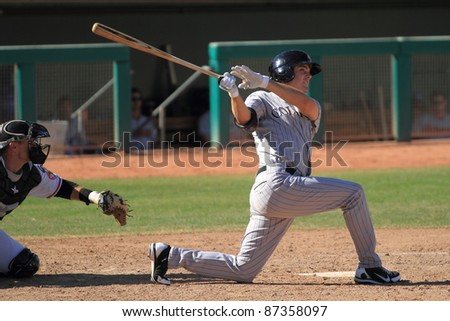 MESA, AZ - OCTOBER 17: Tim Weeler, a Double-A prospect for the Colorado Rockies, bats in an Arizona Fall League game on Oct. 17, 2011 at HoHoKam Stadium, Mesa, AZ. Wheeler doubled and drove in 3 for the Rafters. - stock photo