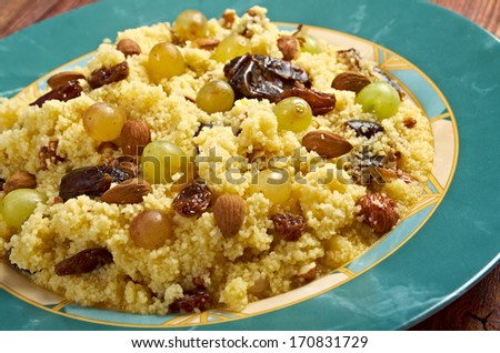 Mesfouf  is an Algerian and Tunisian dish. Citrus Couscous Salad  - stock photo