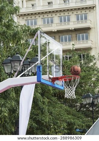 mesh basketball and ball summer in the city - stock photo