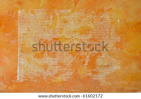 Mesh eyelet in orange concreat wall. - stock photo