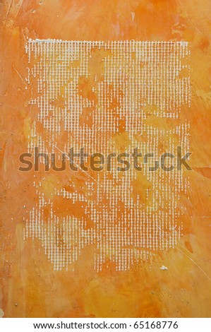 Mesh eyelet in orange concrete wall. - stock photo