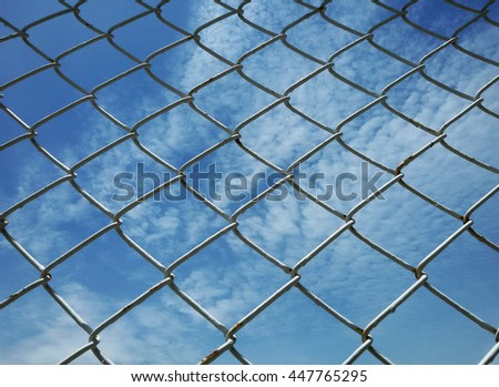 Mesh fence with sky