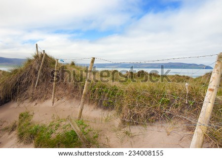 mesh wire fence at the maharees a beautiful beach in county Kerry Ireland - stock photo