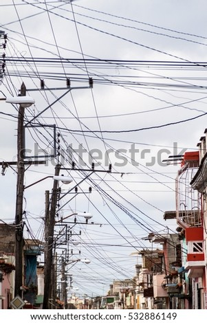 Mess of wires on the street in Camaguey, Cuba