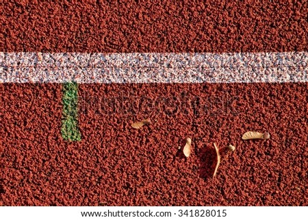 Mess on Direct athletics Running track at Sport Stadium  - stock photo