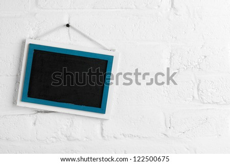 Message board hanging on a white wall. - stock photo