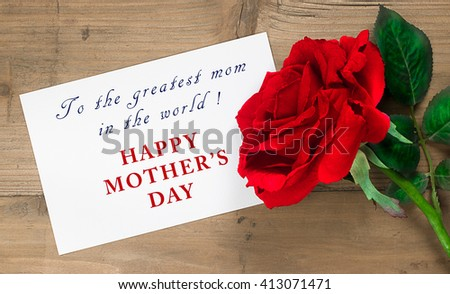 Message for mother's day. Red rose flower with written note on wooden background. - stock photo
