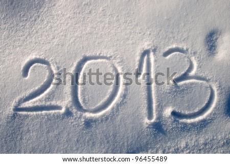 Message handwritten in fresh powdery snow for 2013 - stock photo