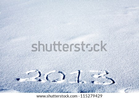 Message handwritten on the snow for 2013 year