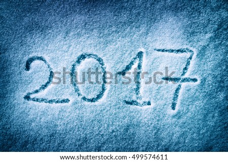 Message handwritten on the snow for 2017 year
