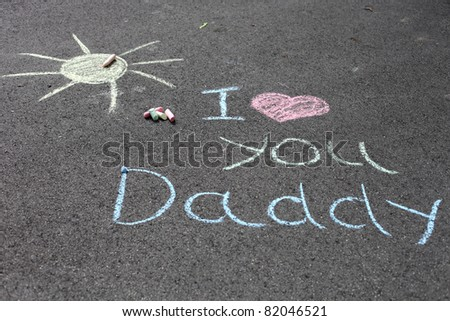 Message i love you daddy written with chalk - stock photo