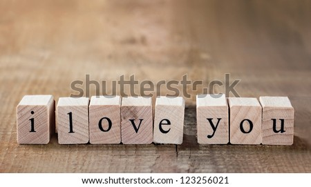 Message I love you spelled in wooden blocks with copy space - stock photo